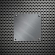 Brushed aluminum plate bolted to a perforated metal background — Stock Photo