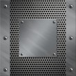 Brushed aluminum frame and plate bolted to perforated metal background — ストック写真 #9294664