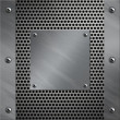 Stockfoto: Brushed aluminum frame and plate bolted to perforated metal background