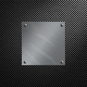 Brushed aluminum plate bolted to a carbon fiber background — Stock Photo