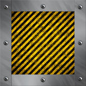 Brushed aluminum frame bolted to a warning stripe background — Foto de Stock