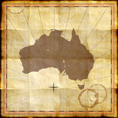 Australia map on old paper with coffee stains — Stock Photo