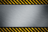 Metal template with warning stripe — Stock Photo