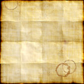 Old paper background with traces of folds and coffee stains — Stock Photo