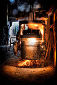 Ladle of molten steel in a iron foundry — Stock Photo