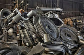 Stack of cast metal parts in a iron foundry — Stock Photo