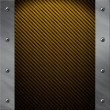 Brushed aluminum frame bolted to a golden carbon fiber background — Stock Photo