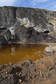 Acidic waters in pyrite smelting landfill — Stock Photo