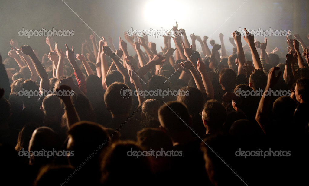 The audience raised their hands at concert  — Stock Photo #10050498