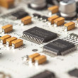 White electronic circuit board, top view — Stock Photo #10195309
