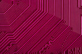 Pink electronic circuit board — Stock Photo