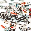 Stock Photo: Scattered cut out letters