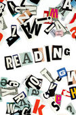 Reading inscription made with cut out letters — Stock Photo
