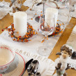 Christmas table set with sculptures — Stock Photo