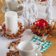 Christmas table set with cup and balls - Stock Photo