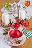 Christmas table set with candles and balls — Stock Photo