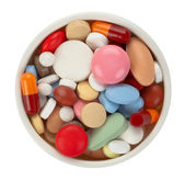 Colored pills in white bowl - top view — Stock Photo