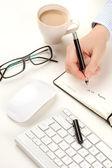 Businessman desk with hand and pen — Φωτογραφία Αρχείου