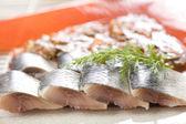 Four herring slices — Stock Photo