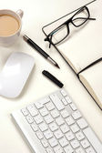 Businessman desk and coffee — Stock Photo
