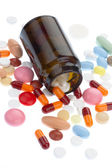 Pills pouring out of the brown bottle — Stock Photo