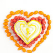 Heart made with gingerbread and dragees of peanuts — Stock Photo #9035558