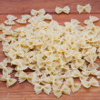 Raw uncooked farfalle pasta — Stock Photo