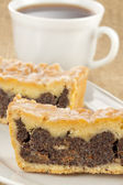 Poppy-seed cale with coffee — Stock Photo