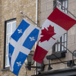 Stock Photo: Flags of Quebec and Canada
