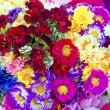 Stock Photo: Background of colorful artificial flowers