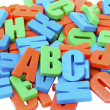 Colorful alphabet letters on a magnet — Stock Photo #10481220