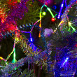 Christmas background of tinsel and garland — Stock Photo