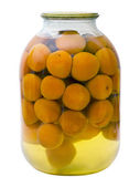 Glass jar with a compote of canned apricots — Stock Photo