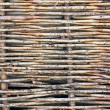 Wattle fence of dry twigs — Stock Photo