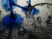 Wine glasses with dark-blue a leg on crystal glass — Stock Photo