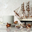 Still life with cup, candy and yacht — Stock Photo #8581633