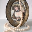 The pearls and a decorative plate — Stock Photo
