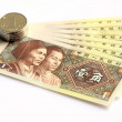 Paper currency and coin — Stock Photo #9417389