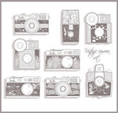 Retro photo cameras set. Vintage cameras. — Vector de stock