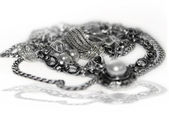 Silver jewelry isolated on white — Stock Photo