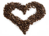 Shape of heart made with the coffee beans — Stock Photo
