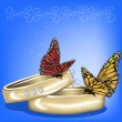 Wedding background with rings and butterflies on blue - Stockvektor