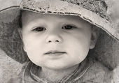 Black and white retro photo of adorable thoughtful little boy closeup — Stock Photo