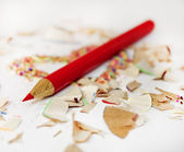 Sharp red pencil among pencils shavings — Stock Photo