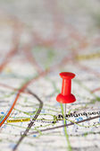 Push pin stuck in a map — Stock Photo