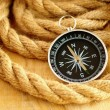 Black compass and marine rope — Stock Photo #9067307