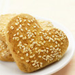 Cookies in the form of heart with sesame seeds on a plate — Stock Photo