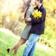 Couple kissing in the autumn park — Stock Photo