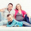 Stock Photo: Little boy and his parents resting