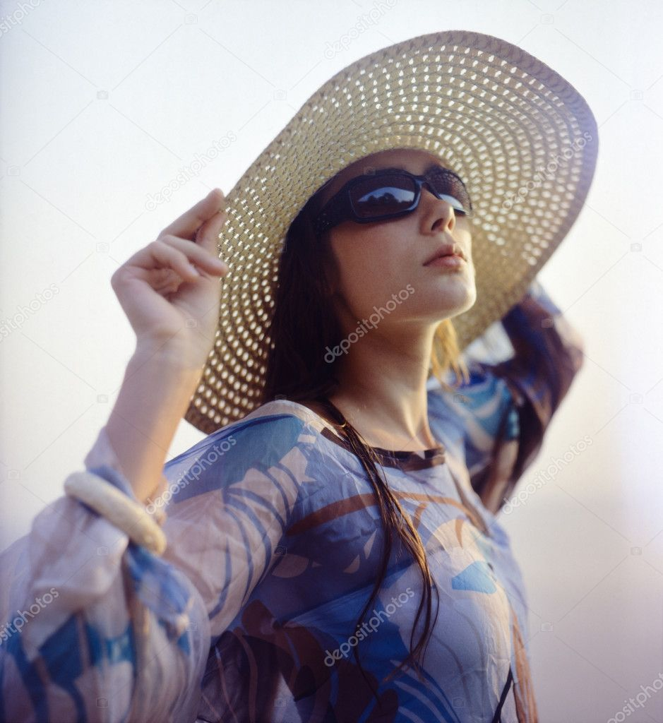 Beautiful girl wearing straw hat and sunglasses on the beach. Film scan, middle format. — Stock Photo #8131678